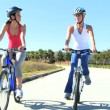 Female Friends Cycling Fun Together — Stock Video