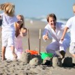 Royalty-Free Stock Векторное изображение: Happy Young Family Enjoying Beach Vacation