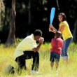 Stock Video: Active Ethnic Family Playing Baseball in Park