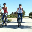 Healthy Female Friends Cycling Together — Stock Video