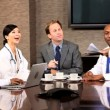 Royalty-Free Stock Vector Image: Five Multi Ethnic Medical People in Team Meeting