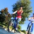 Female Friends Cycling Together — Stock Video #23335338