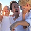 Stock Video: Loving Family Quiet Time Together at Beach
