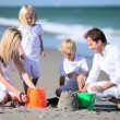 Caucasian Family Building Sand Castles — Stok video