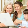Children and Grandparents Using Laptop for Online Games — Stock Video