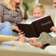 Young Caucasian Family with Photograph Album - Stock Photo