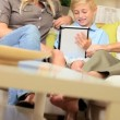 Young Family at Home Using a Wireless Tablet - Stock Photo