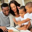 Young Family Using Wireless Tablet for Online Video Chat - Stock Photo