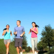 Young Running Partners on Suburban Roads - 