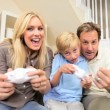 Parents Having Fun with Son on Games Console — Stock Video