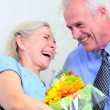 Stock Video: Senior Lady in Hospital with Husbands Flowers