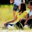 Young Ethnic Family Fun in the Park - Stock Photo