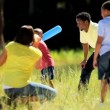 Ethnic Family Playing Baseball in Park - Stock Photo