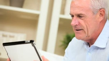 Retired Male Using a Modern Wireless Tablet — Stock Video
