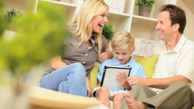 Young Boy and his Parents With a Wireless Tablet — Stock Video