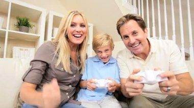 Caucasian FamilyPlaying Handheld Electronic Game — Stock Video