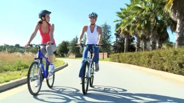 Young Females Keeping Fit and Healthy Cycling — Stock Video