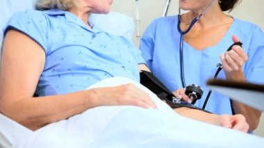Hospital Staff Treating Senior Female Patient — Stock Video