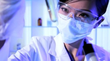 Asian Chinese Researcher in Forensic Laboratory — Stock Video