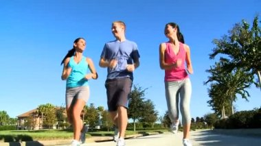Three Young Friends Jogging Together — Stock Video