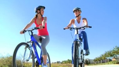 Fit Young Female Friends Cycling Together — Stock Video
