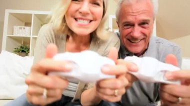 Retired Caucasian Couple Playing on Games Console — Stock Video