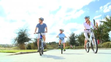 Healthy Caucasian Family Bike Riding Together — Stock Video