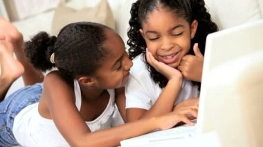Little Ethnic Girls Playing on Laptop — Stock Video