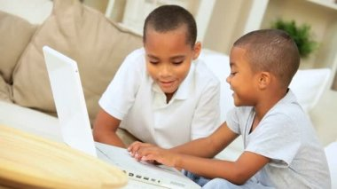 African American Boys with Laptop on Sofa — Stock Video