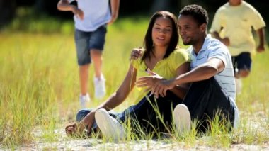 Young Ethnic Family in the Park — Stockvideo