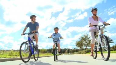 Caucasian Parents and Son Outdoors Cycling — Stock Video