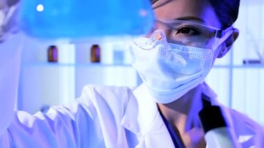 Female Lab Technician Doing Forensic Research Experiments — Stock Video