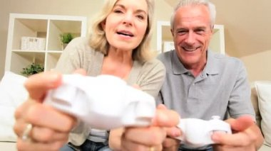 Senior Couple Having Fun with Electronic Games — Stock Video