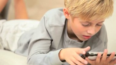 Caucasian Child with Modern Wireless Tablet — Stock Video