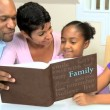 African American Family with Photograph Album - Stock Photo