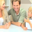 Young Blonde Boy Using Wireless Tablet with Parents — Stock Video