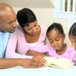 Little African American Girl Reading with her Family — Stock Video