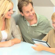 Young Family at Home Using a Wireless Tablet — Stock Video