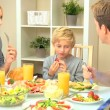 Young Caucasian Family Eating Healthy Lunch Together — Видео