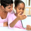 African American Mother and Daughters with Wireless Tablet — Stock Video