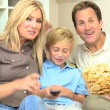 Caucasian Family Watching Movies with Snack Food — Stock Video #23411818