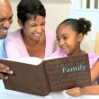 Young Ethnic Family Enjoying Photograph Album — Stock Video
