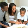 Proud Young Parents Listening to their Son Reading — Stock Video