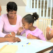 Stock Video: Little AfricAmericGirls Drawing Pictures
