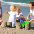 Happy Young Family Enjoying Beach Vacation — Vídeo de stock