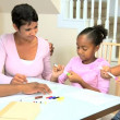Stock Video: Little Ethnic Girls Using Coloring Pens