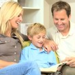 Little Boy and his Parents with a Book — Stock Video #23412974