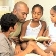 Stock Video: Young Ethnic Child Reading Aloud to Family