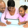 Young Parents Watching Children Using Wireless Tablet — Stock Video #23413064