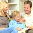 Caucasian Parents and Son Reading a Book — Stock Video #23413674